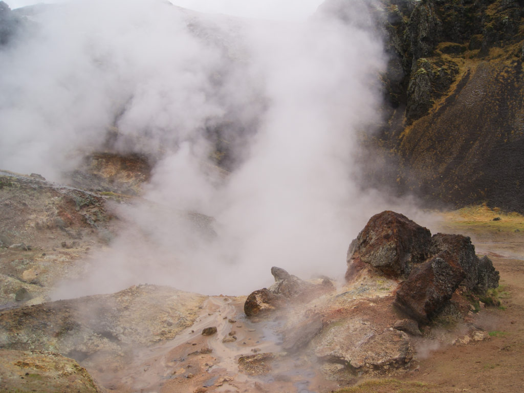 Rocky Geothermal vents with hot steam near Reykjadalur Hot Spring River in Iceland