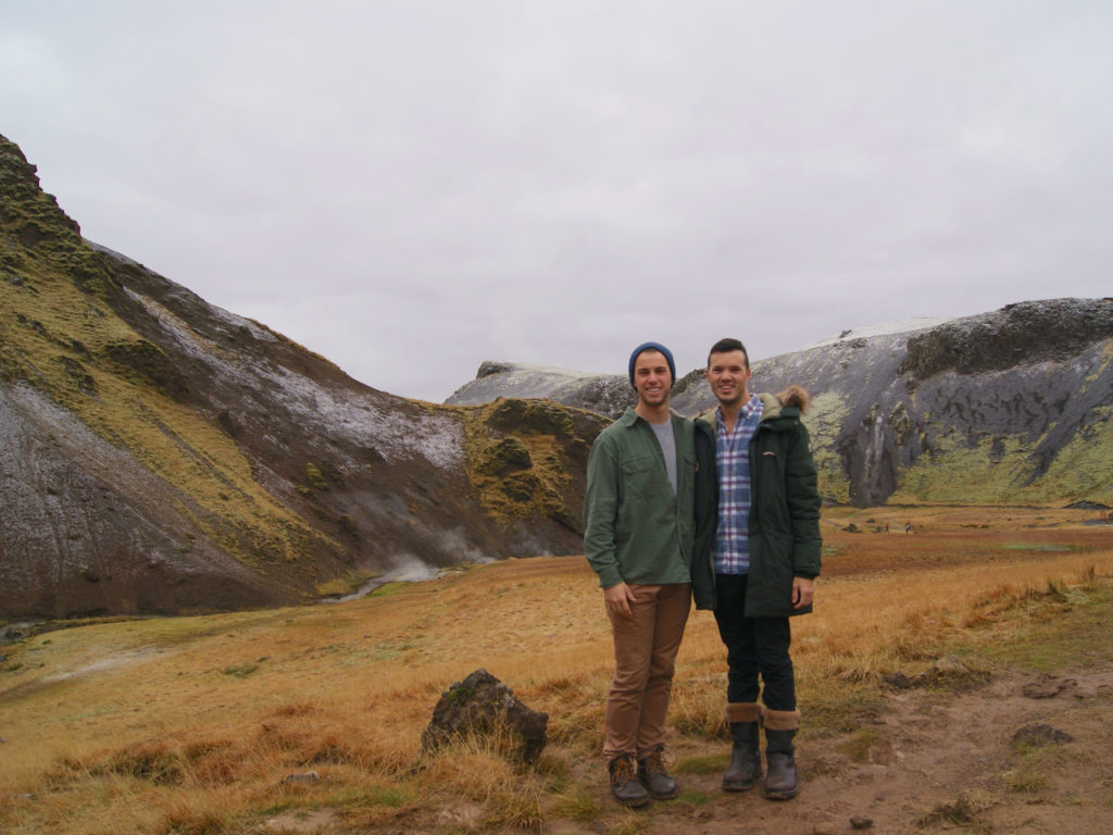 Gay couple hiking to Reykjadalur Hot Spring River in Iceland
