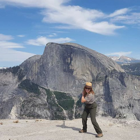 National Park ranger in front of Half Dome in Yosemite National Park
